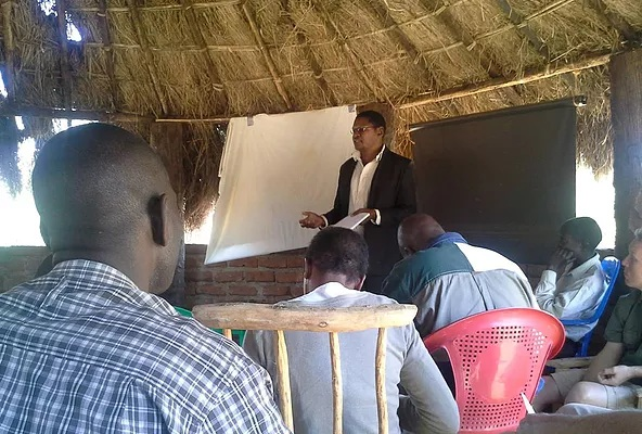 Godfrey Phiri, Senior Community Engagement Manager - BioCarbon Partners, facilitating community engagement at the center of community forest protection in Zambia,