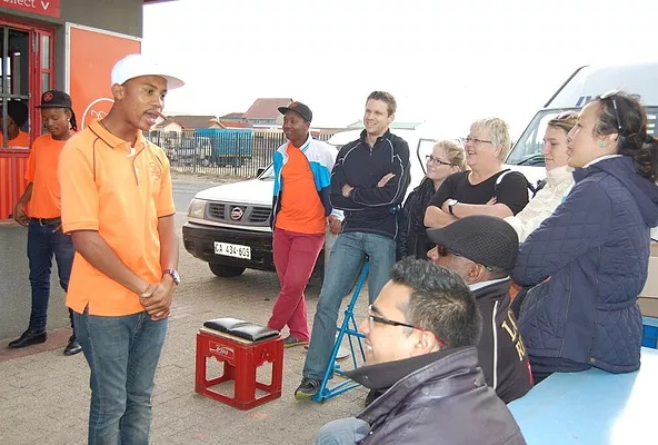 Guests get an introduction to  Department of Coffee in Khayelitsha, Cape Town, South Africa.