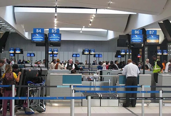 Travellers at the ever busy OR Tambo International Airport in Johannesburg, South Africa.