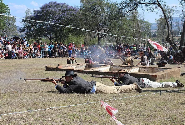 British soldiers fire gun shots at Boer soldiers as participating crowd watch with keen interest during the re-enactment of the battle of Talana.