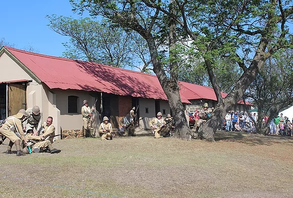 Boer soldiers carrying a fellow wounded soldier to the armory during the re-enactment of the battle of Talana.