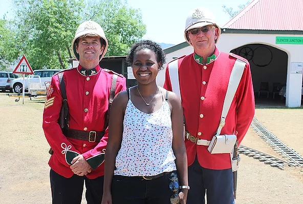 Nomad Africa Magazine journalist, Jane Sikwe, poses with two British red coat soldiers at the event.