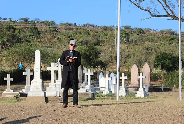 A priest coordinating proceedings at the Talana cemetery down the slopes of Talana battle hill. Monuments in the cemetery commemorate all three regiments, which fought at Talana.