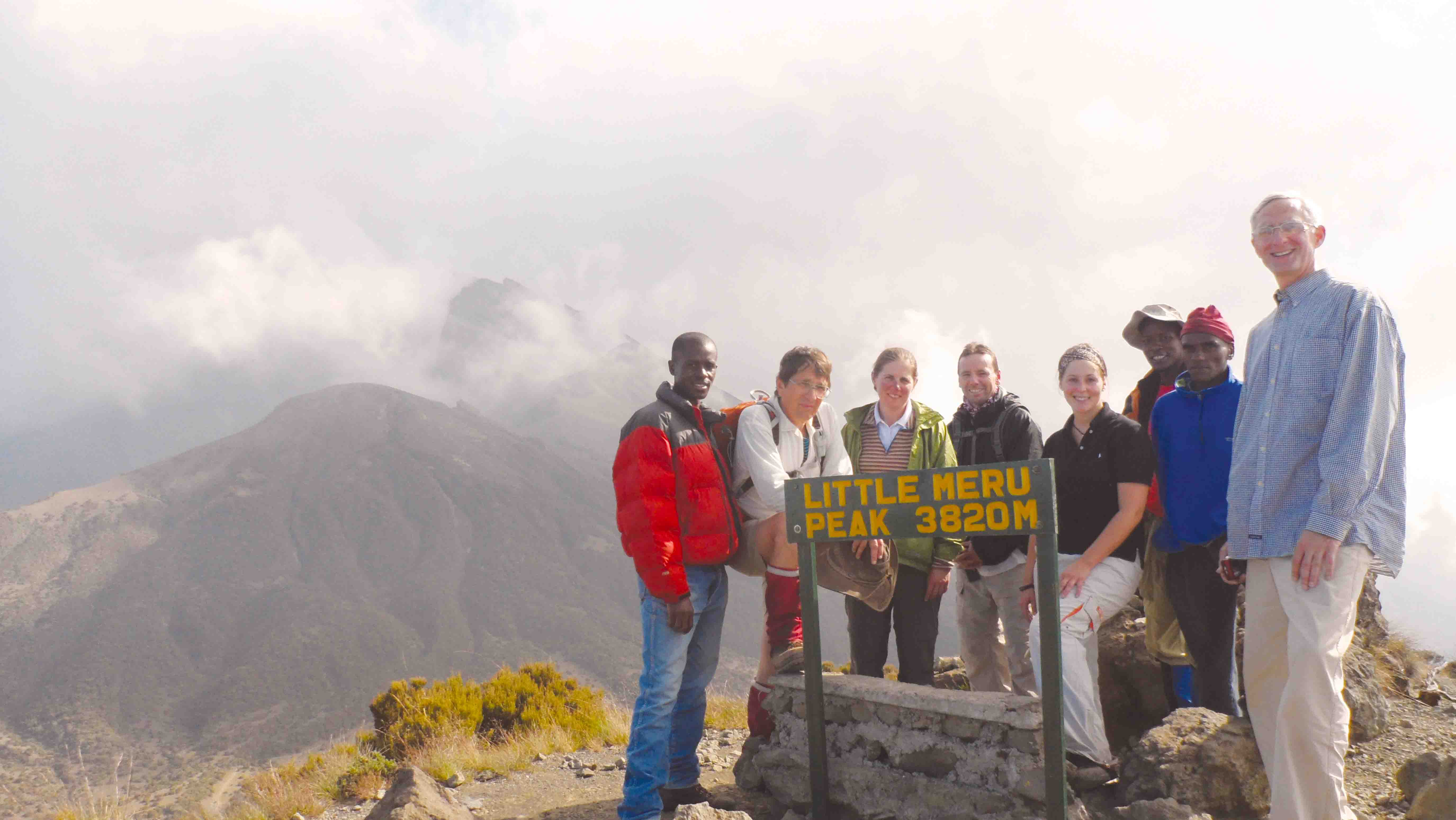Our group with other locals at the peak of Mt. Meru.